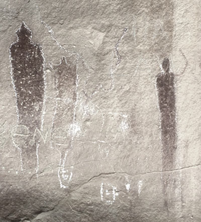 cave painting with figures