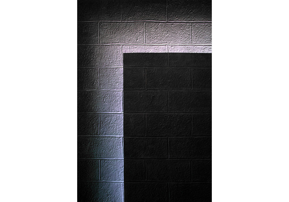 A cinderblock wall that wants to shine
