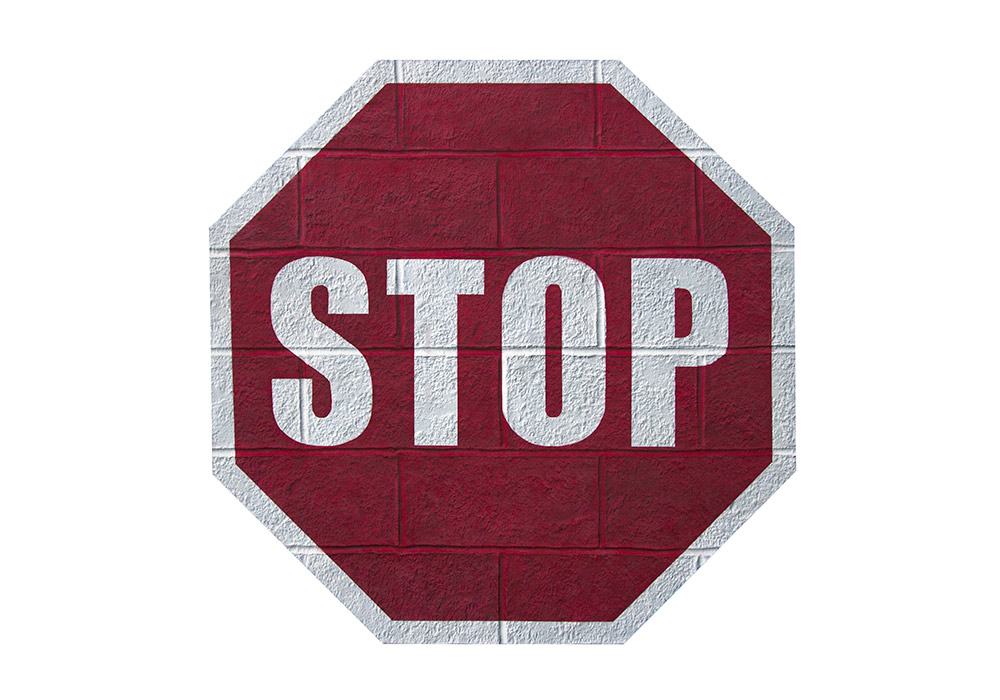 A Cinder block wall that wants to be a STOP sign
